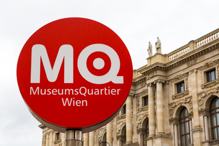 wien: Vienna, Austria - April, 2, 2015: MuseumsQuartier Wien sign and the museum building with the statues at the background
