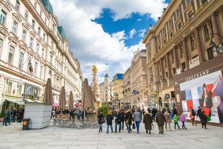plague: Vienna, Austria - April 3, 2015: Plague column and Graben Street view with people walking in Vienna, Austria Editorial