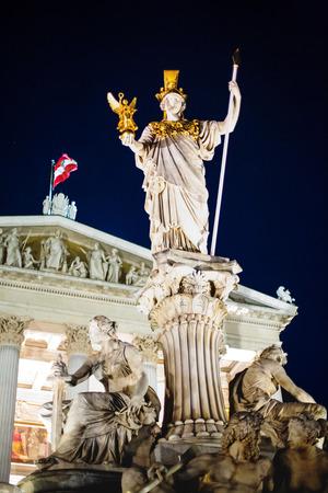pallas: Night view of Parliament building in Vienna, Austria and Pallas Athena Brunnen statue