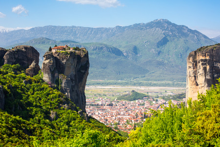 kalambaka: Aerial view of monastery at Meteora cliff  in Greece and traditional greek Kalambaka town with red roofs