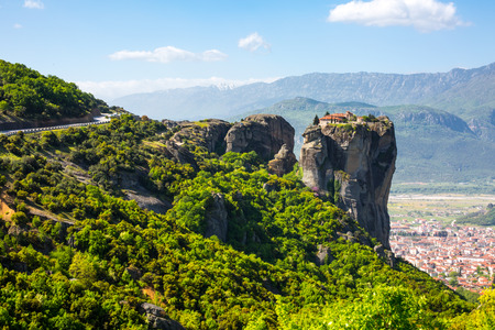 kalambaka: Aerial view of monastery at Meteora cliff  in Greece, the road and traditional greek Kalambaka town with red roofs Stock Photo