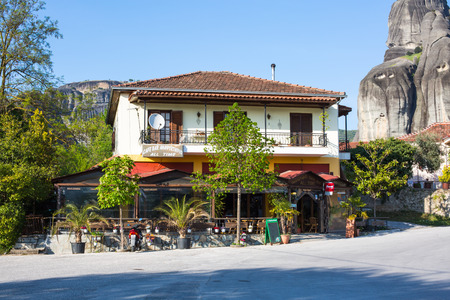 meteora: Meteora, Greece - April 27, 2015: Outdoor view of the traditional Greek tavern surrounded with Meteora cliffs in Kastraki village, Greece Editorial