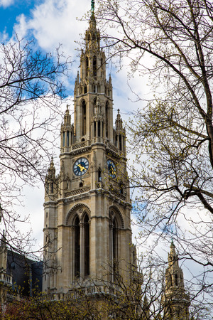 rathaus: Vienna Town Hall,  Wiener Rathaus, Austria against the cloudy sunny sky