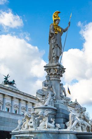 pallas: Parliament building in Vienna Austria and statue of Pallas Athena Brunnen Stock Photo