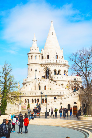 fisherman bastion: Budapest, Hungary - March 29, 2015: Tourists at Fisherman Bastion on the Buda Castle hill in Budapest, Hungary