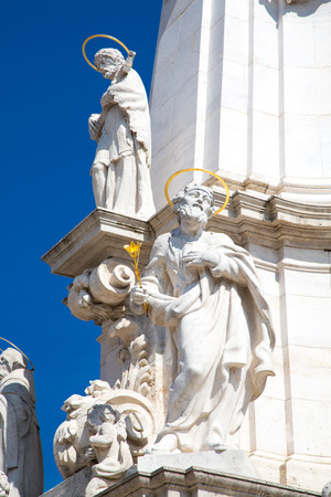 Sculptures of Holy Trinity column outside of Matthias Church in Budapest Hungary photo