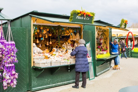 eastertime: Vienna, Austria - April 3, 2015: Sellers preparing for selling  of colorful Easter souvenirs at traditional Easter market near Schonbrunn palace in Vienna, Austria