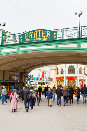 prater: Vienna, Austria - April, 5, 2015: Entrance to the Prater amusement park in Vienna and people going in and out Editorial