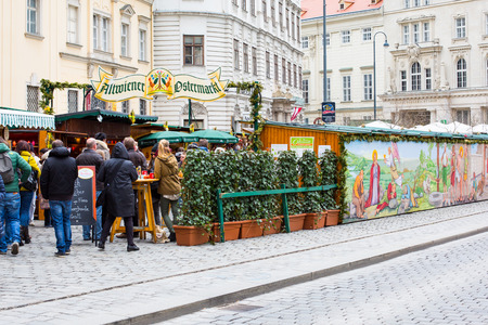 eastertime: Vienna, Austria - April 5, 2015: Entrance to the oldest traditional market Freyung in Vienna, people entering Editorial