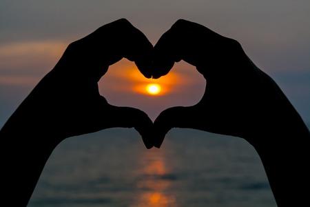 hand forming heart shape photo