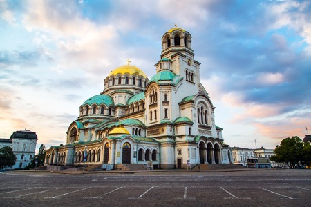 temple tower: St. Alexander Nevsky Cathedral in the center of Sofia, capital of Bulgaria against the blue morning sky with colorful clouds Stock Photo