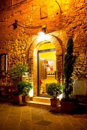 montepulciano: Montepulciano, Italy - November, 14, 2014: Hotel Duomo entrance in medieval town Montepulcino in Tuscany, Italy Editorial