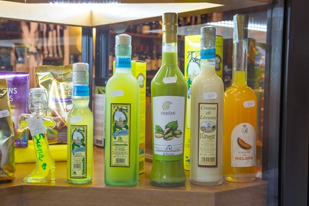 speciality: Siena, Italy - November 16, 2014:  Traditional italian speciality limoncello liqueur bottles for sale for tourists in souvenir store Editorial