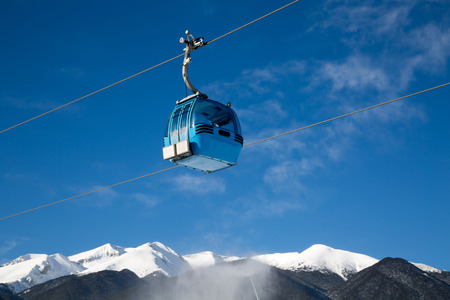 cable car: Cable car cabin and snow peaks of the mountains view