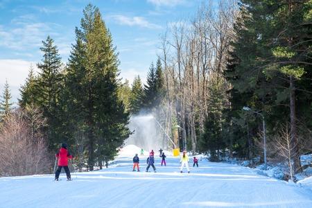 Bansko, Bulgaria - February 19, 2015:  Skiers on the slope in Bansko, Bulgaria