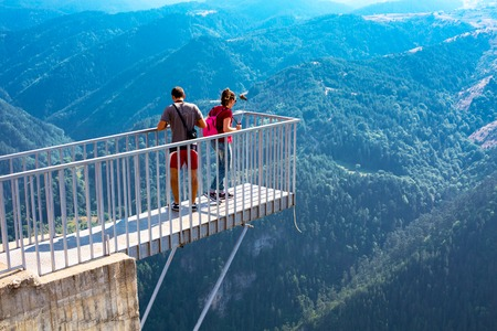 oko: Rhodope, Bulgaria - July 29, 2015: People taking photo at panoramic mountain viewpoint Eagle eye, Orlovo Oko in Rhodope or Rodopi mountains in Bulgaria. The platform is mounted on the edge of the cliffs. Editorial