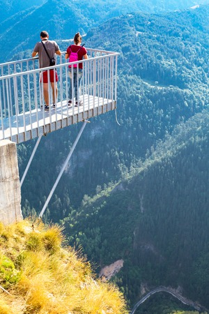 oko: Rhodope, Bulgaria - July 29, 2015: People  at panoramic mountain viewpoint Eagle eye, Orlovo Oko in Rhodope or Rodopi mountains in Bulgaria. The platform is mounted on the edge of the cliffs.