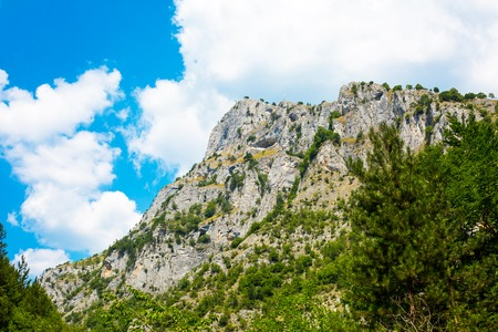 oko: Background with the rocks and trees at Rhodope or Rodopi mountains in Bulgaria and Eagle Eye viewpoint up on the rock. Bulgarian name Orlovo Oko Stock Photo