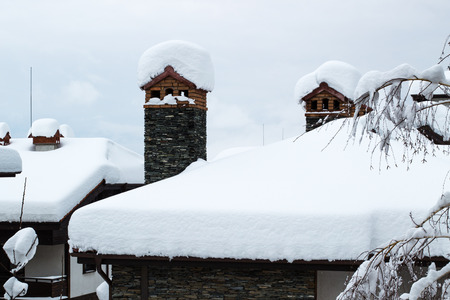 chalet: Snow covered chimney and chalet roof Stock Photo