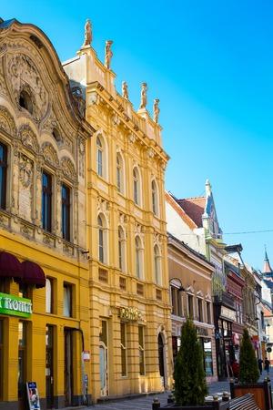 brasov: Brasov, Romania - March 24, 2015: Buildings of the pedestrian street Republicii in downtown of Brasov, Transylvania, Romania.
