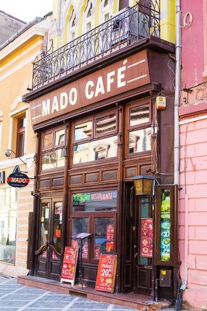 brasov: Brasov, Romania - March 24, 2015: Cafe at the pedestrian street Republicii in downtown of Brasov, Transylvania, Romania. Editorial