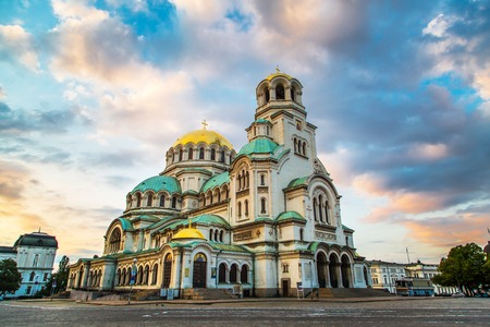 blue church: St. Alexander Nevsky Cathedral in the center of Sofia, capital of Bulgaria against the blue morning sky with colorful clouds Stock Photo