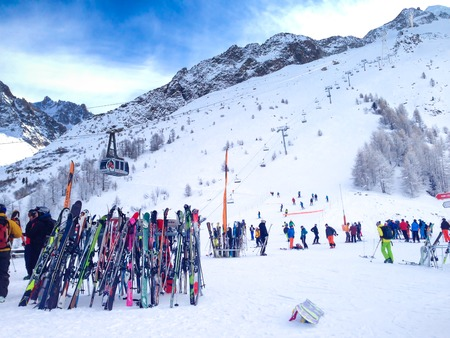 Chamonix, France - January , 24, 2015: People skiing, pile of Skis and slopes view at Les Grands Montets ski area near Chamonix, France