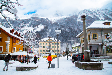 Chamonix, France - January , 30, 2015: Street view, Outdoor Bar, post office, people walking in the center of Chamonix town in French Alps, France Editorial