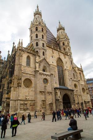 stephansplatz: Vienna, Austria - April 5, 2015: Tourists near St. Stephens Cathedral in Stephansplatz, Vienna, Austria