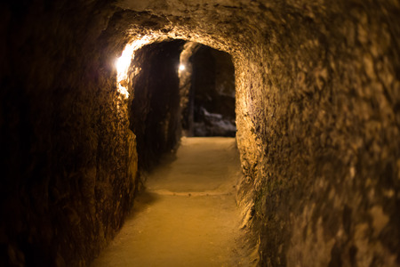 catacomb: Background with the stone arch at the old dark wine cellar Stock Photo