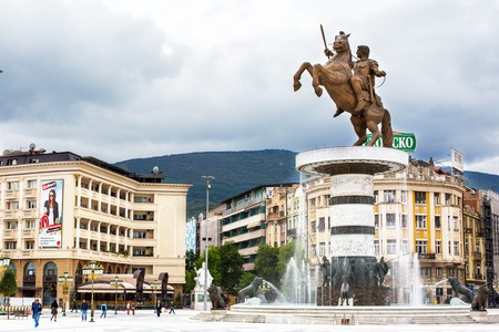 alexander the great: Skopje, Macedonia - September, 30, 2015: Statue of Alexander the Great on main square in downtown of Skopje, fountain and people walking around