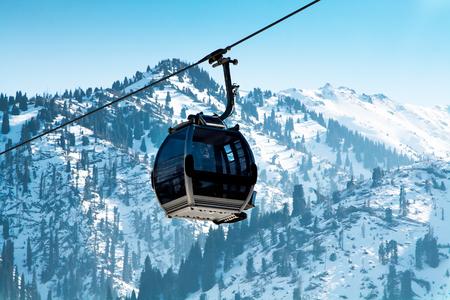 Almaty, Kazakhstan - March, 2, 2014:  Ski lift, Gondola lift, cable car at Medeo to Shymbulak route near Almaty against mountain background