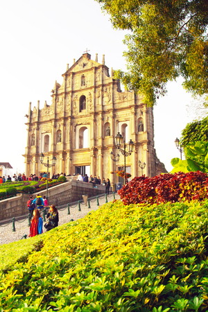 saint pauls cathedral: Macau, Macau- January, 10, 2014: The facade of Saint Pauls Cathedral in Macau. People walking and taking photos around it