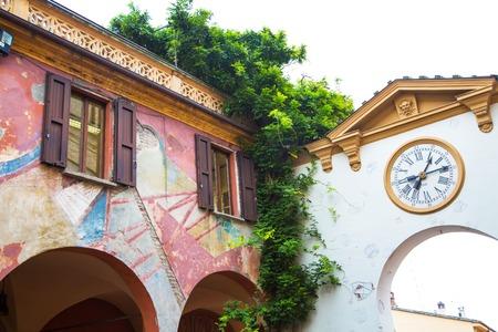 architectural architectonic: Dozza,  Italy - November, 13,2014: Houses, paintings and clock in  Dozza, Emilia-Romagna, Italy. Editorial