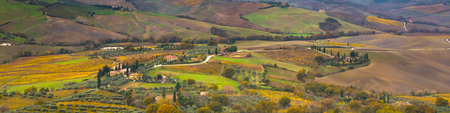 montepulciano: Vibrant autumn Tuscany panoramic landscape with houses, fields, cypress, vineyards, Italy Stock Photo