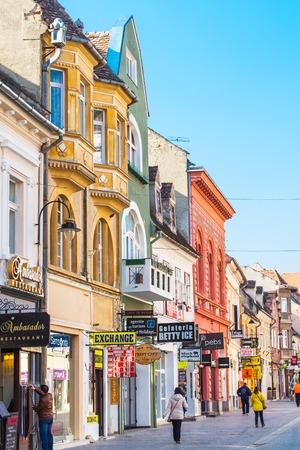 brasov: Brasov, Romania - March 24, 2015: People at the pedestrian street Republicii at downtown of Brasov, Transylvania, Romania. Black church is seen a distance away. Editorial