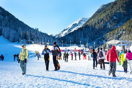ski walking: Bansko, Bulgaria - December, 12, 2015: Ski resort Bansko, Bulgaria, pistes and mountain with pine trees, ski slope, people walking and skiing