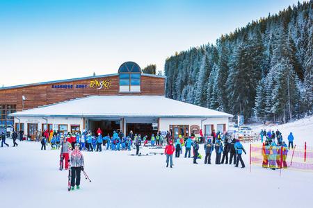 station ski: Bansko, Bulgaria - December 12, 2015: Bunderishka polyana, ski station, cable car lift, Bansko, Bulgaria, people