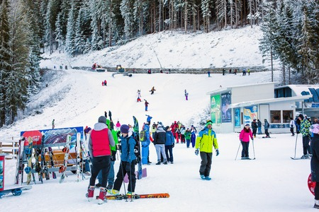 ski walking: Bansko, Bulgaria - December, 12, 2015: Vibrant image of ski resort Bansko, Bulgaria, pistes and mountain, ski slope, people walking and skiing, snowcat Editorial