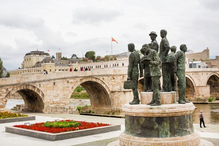 macedonian flag: Skopje, Macedonia - September, 30, 2015: Statue, Macedonian flag and bridge in downtown of Skopje