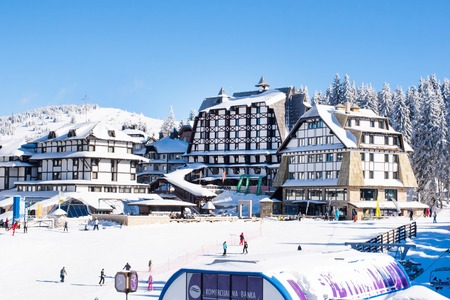 ski walking: Kopaonik, Serbia - January 22, 2016: Panorama of ski resort Kopaonik, Serbia, ski slope, people, houses, restaurants in winter time