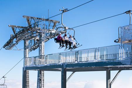 station ski: Kopaonik, Serbia - January 22, 2016: Skiers arriving to the station on the ski lift