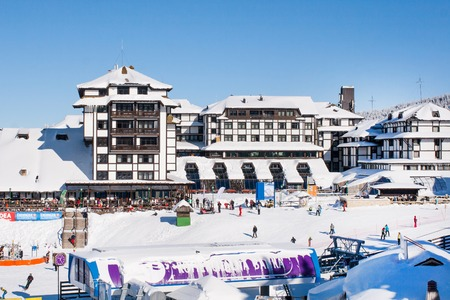 ski walking: Kopaonik, Serbia - January 22, 2016: Panorama of ski resort Kopaonik, Serbia, hotels, restaurants, people walking and skiing, mountains view in winter time