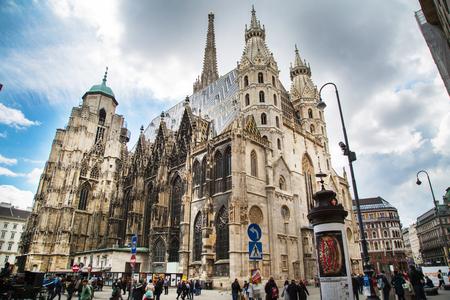 stephansplatz: Vienna, Austria - April 5, 2015: Exterior view of Vienna landmark, St. Stephens Cathedral in Stephansplatz and people near it
