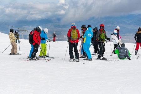 station ski: Bansko, Bulgaria - March 4, 2016: Ski resort, skiers at the high lift station, Bansko, Bulgaria Editorial