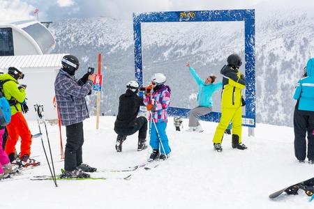 station ski: Bansko, Bulgaria - March 4, 2016: Ski resort, people taking photoes at upper station, Bansko, Bulgaria