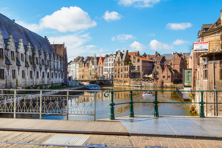 benelux: Ghent, Belgium - April 12, 2016: View of old colorful traditional houses along the canal, part of bridge in popular touristic destination Ghent, Belgium