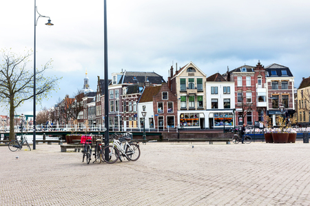europe vintage: Leiden, Netherlands - April 7, 2016: Traditional houses and bicycles at the square in Leiden, Holland, Netherlands