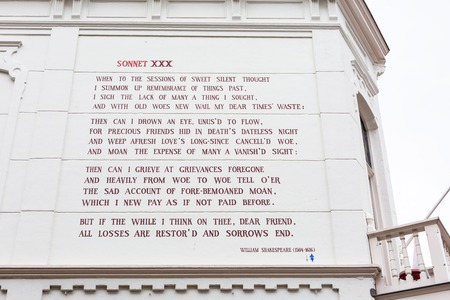 Leiden, Netherlands - April 7, 2016: William Shakespeare sonnet at the wall of house in Leiden, Holland. The city of Leiden is decorated throughout with 101 'wall poems'