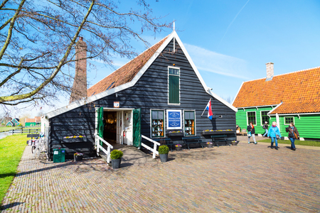 zaanse: Zaanse schans, Netherlands - April 1, 2016: Delft Blue pottery shop in Zaanse Schans, North Holland, traditional village, tourists